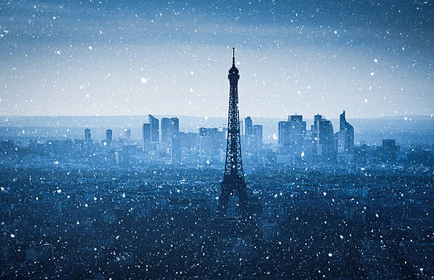 Panoramic view on Eiffel Tower on a snowy winter evening (Paris, France).